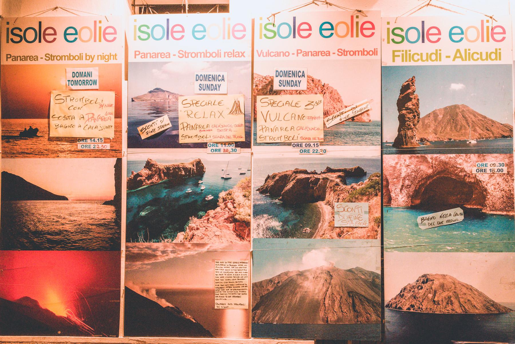 posters advertising tours of the seven aeolian islands of lipari, salina, vulcano, stromboli, alicudi, filicudi, panarea