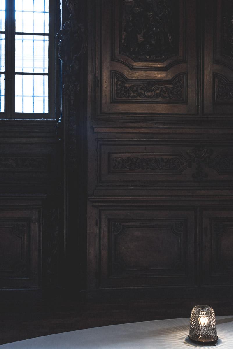 A Saint Louis crystal lamp lighting up a dark wooden church in Santa Maria Del Carmine for Fuorisalone Milan Design Week 2019