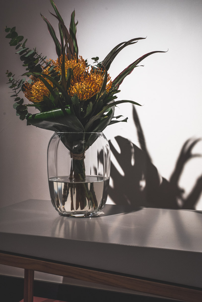 Still life with a vase and orange spiky flowers, a photography shot during Fuorisalone Milan Design Week 2019 at the Netherland exhibition