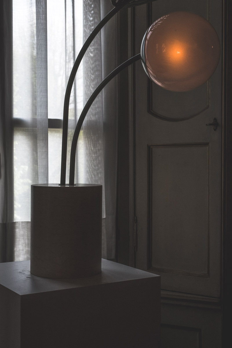 A rounded Lamp near a window during Fuorisalone Milan Design Week 2019