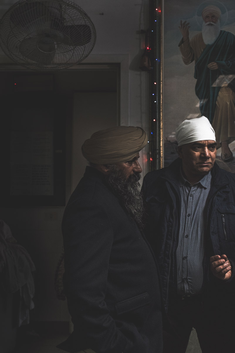Two Sikh men solemny attending the Vaisakhi celebration in the city of Novellara