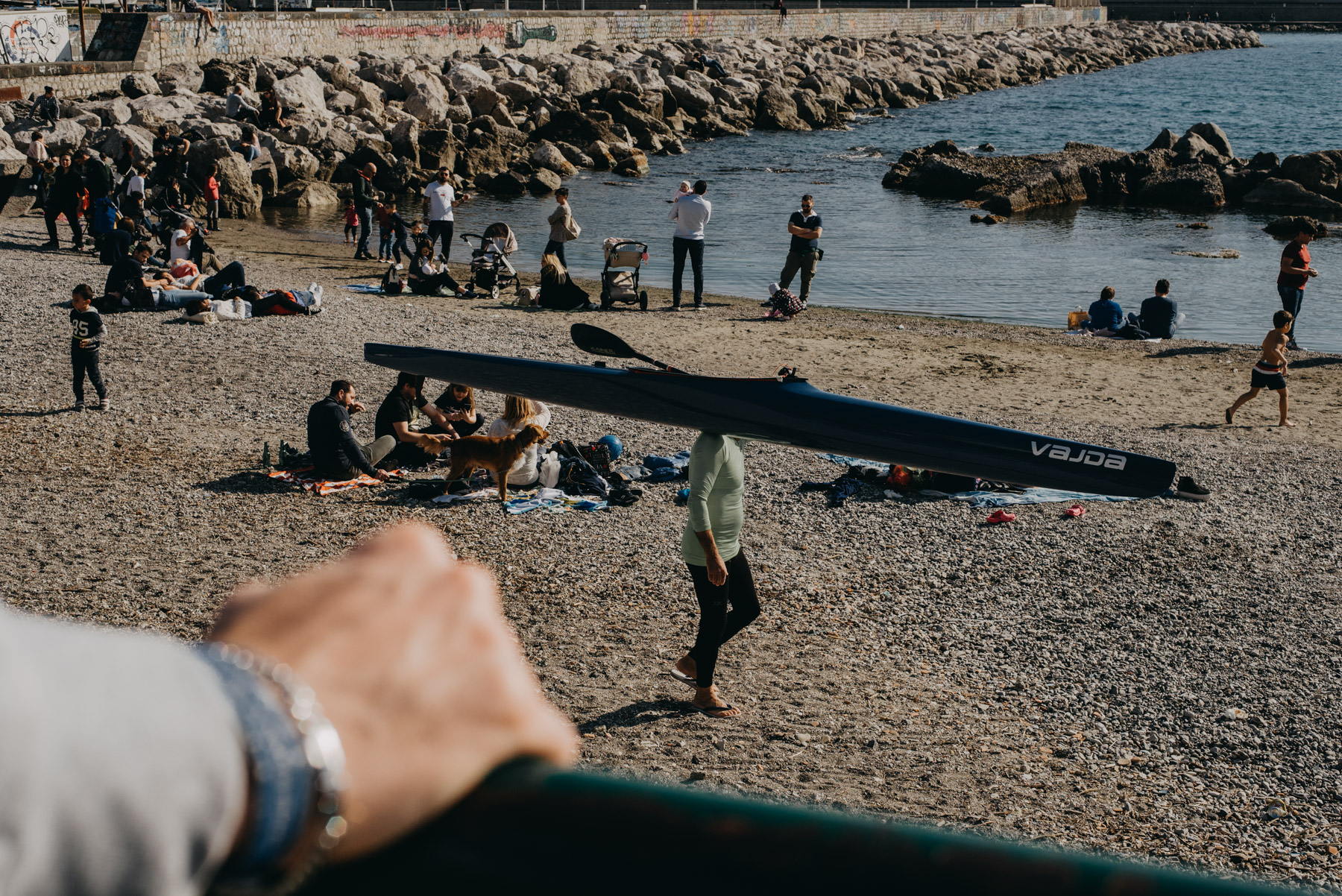 street photography showing people on the beach in the city of Salerno