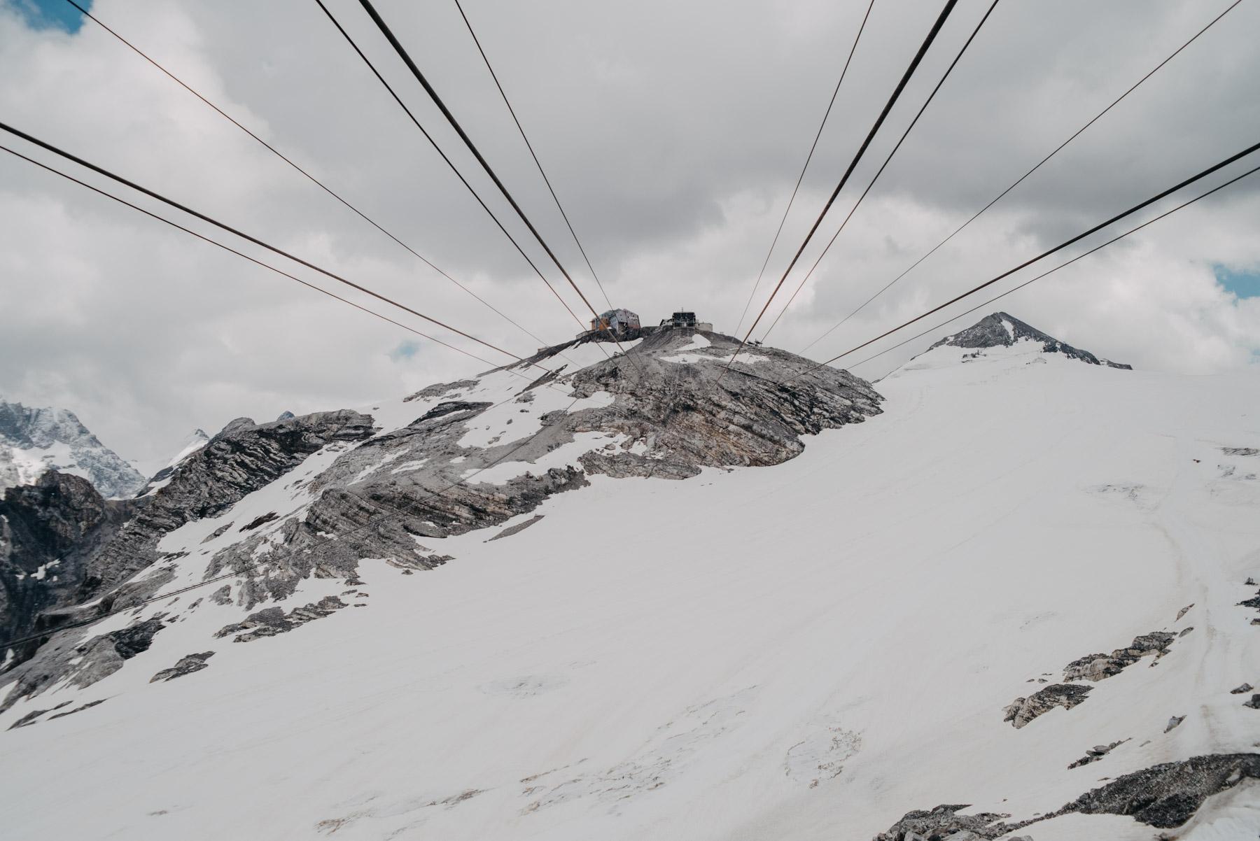 Summer snow on the mountains near the Stelvio pass with cables of the cableway in sight, Neve estiva sulle montagne del passo dello Stelvio con i cavi della funivia