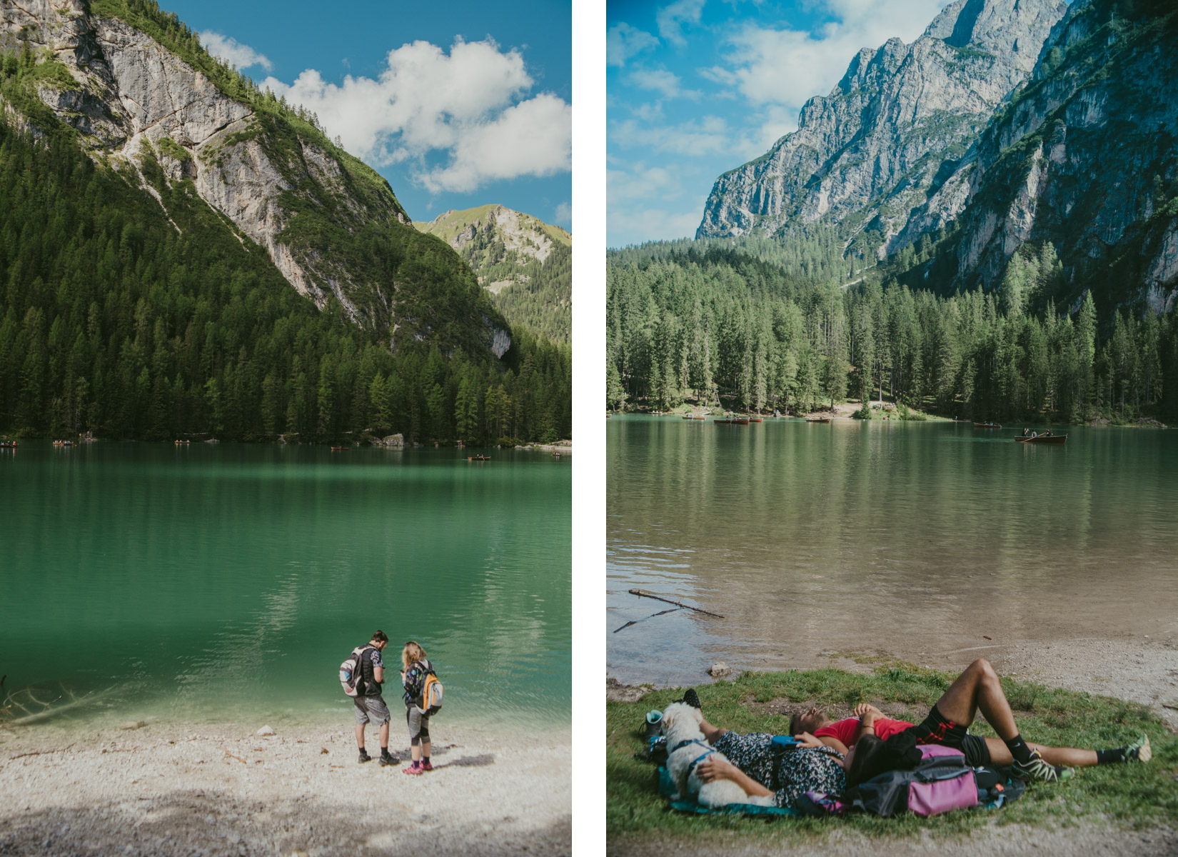 A panoramic view of Braies Lake on the Dolomites with people on the foreground enjoying some relax on the grass and watching their mobile phones ; vista panoramica del lago di Braies con delle persone alcune delle quali si rilassano stese sull'erba e altre consultano dei cellulari