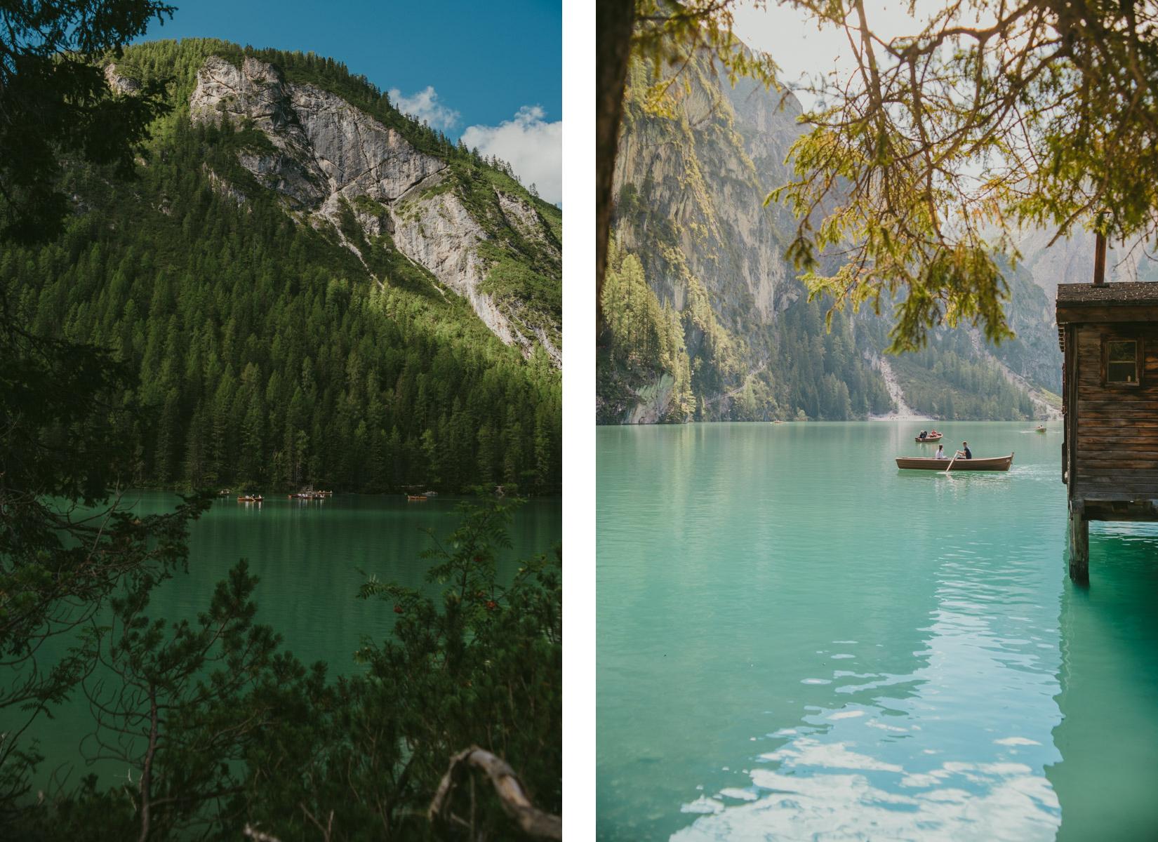 A panoramic view of Braies Lake on the Dolomites with some little boat floating on it ; una veduta panoramica del lago di Braies con piccole barche sullo sfondo