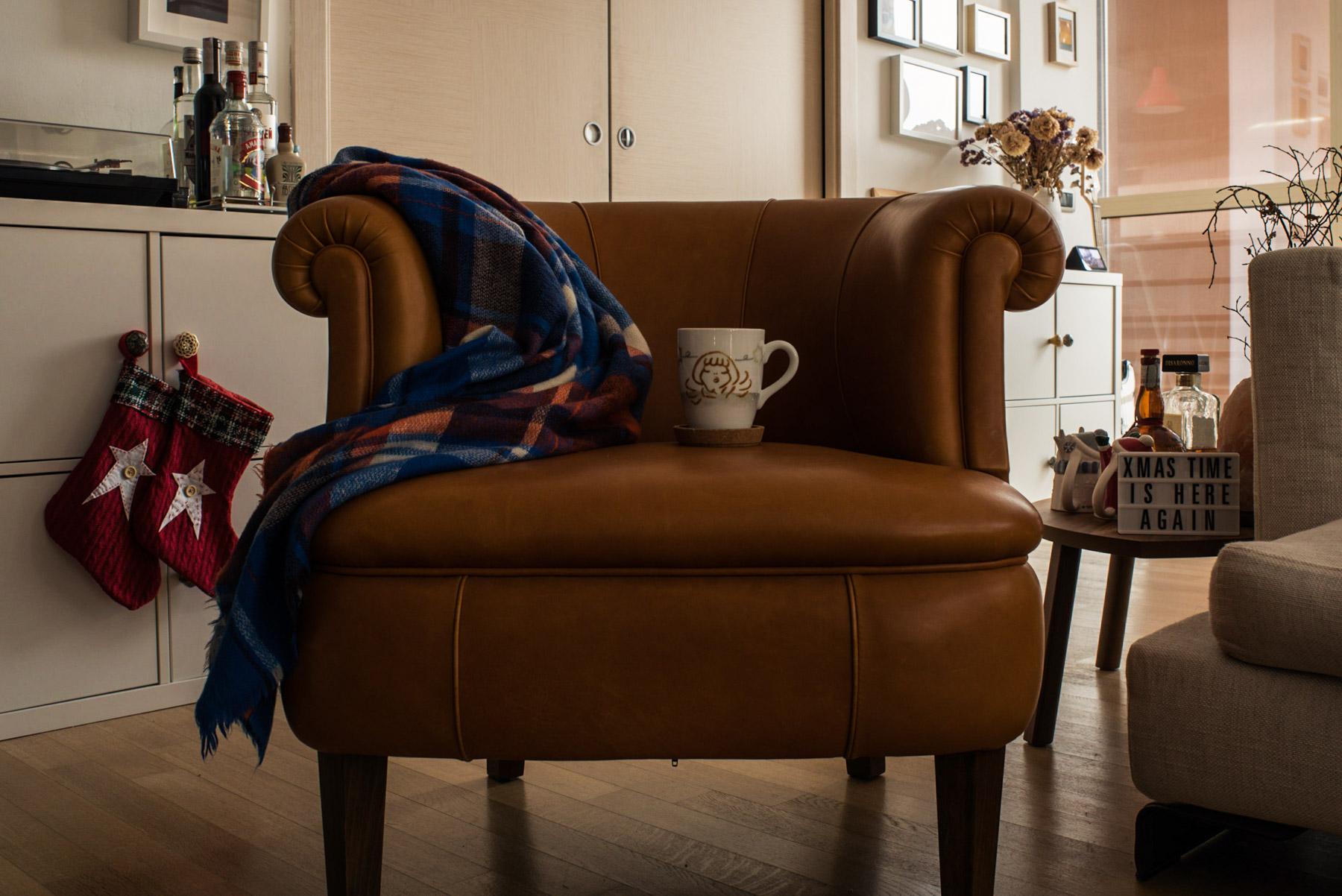 A sofa, a blanket and a mug during Christmas