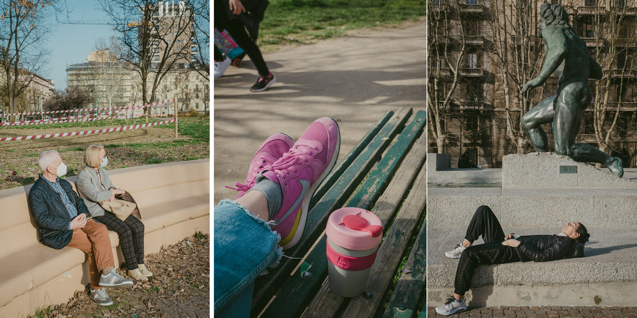 A couple sat on the Vittorio Formentano Park in Milan, a girl relaxes beneath the sun near a big Statue, someone drinks from a Keep Cup mug on a bench